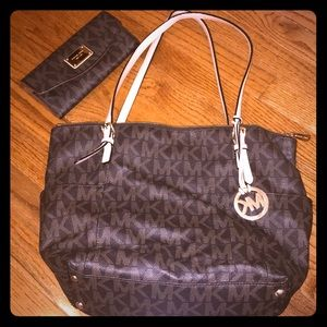 Brown Michael Kors purse and wallet